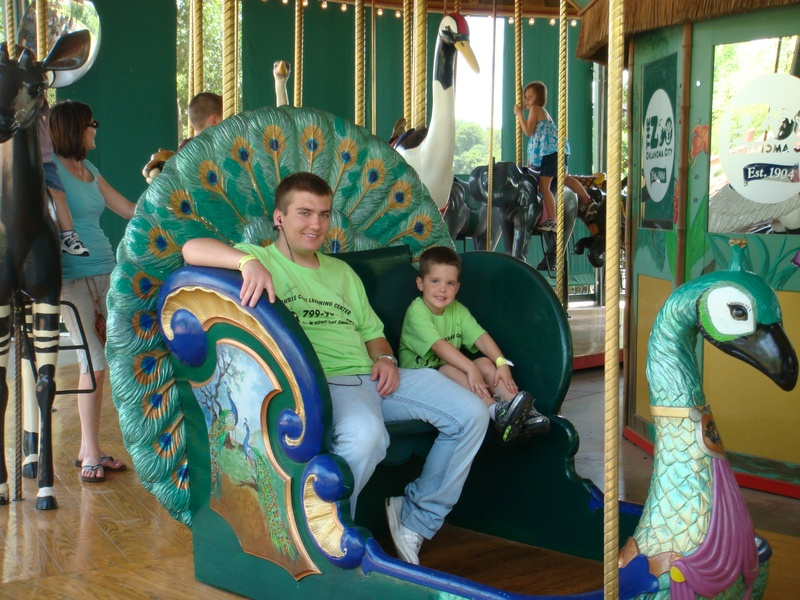 CJ and Ty relaxing on the carousel